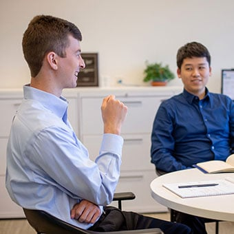 two people meeting at table in office